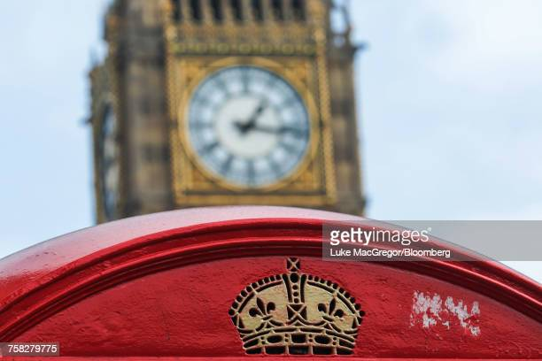a traditional red telephone box stands in front of big ben - big mac stock pictures, royalty-free photos & images