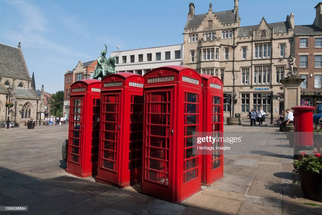 Traditional Red Telephone Boxes In The Central Square Of Durham City