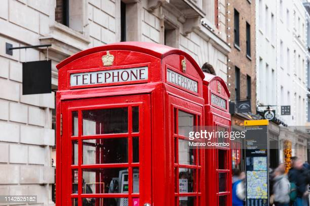 traditional red telephone boxes, london, united kingdom - english culture stock pictures, royalty-free photos & images