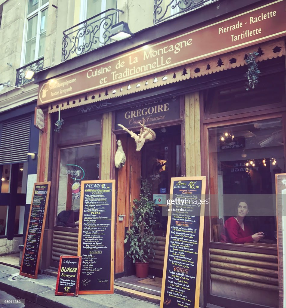 Traditional restaurant in Paris, France. : Stock Photo