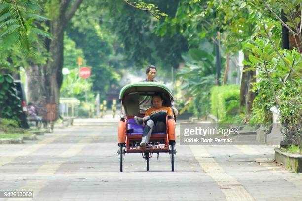traditional becak - yogyakarta stock photos and pictures