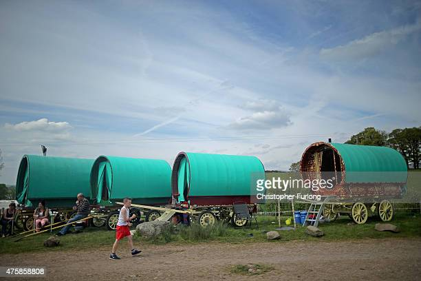 Traditional romany caravans camp on Fair Hill during the Appleby Horse Fair on June 4 2015 in Appleby England The Appleby Horse Fair has existed...