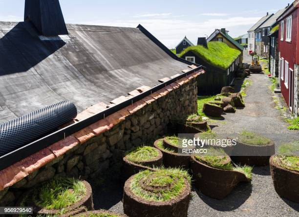 Traditional roofing with sod The village on the island Mykines part of the Faroe Islands in the North Atlantic Denmark Northern Europe