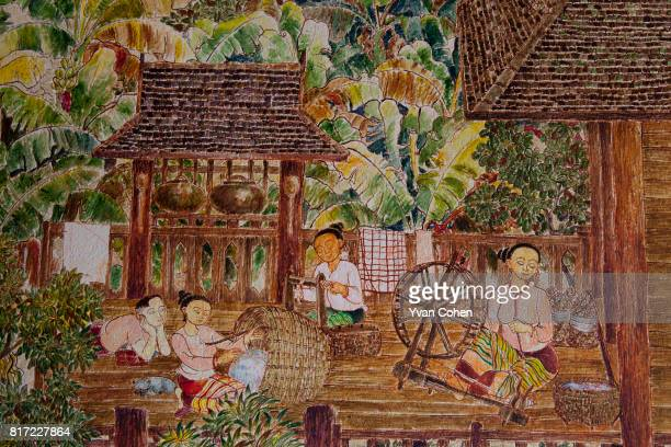 Traditional rural scenes, including villages spinning cotton and relaxing in front of their homes, are part of a mural which adorns the walls of the...