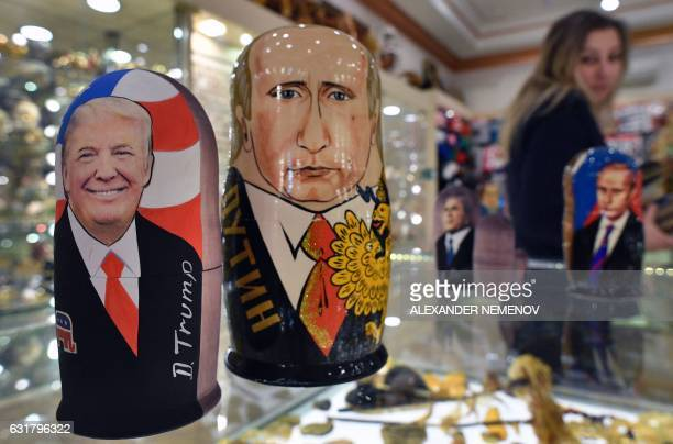 Traditional Russian wooden nesting dolls Matryoshka dolls depicting US Presidentelect Donald Trump and Russian President Vladimir Putin are seen at a...