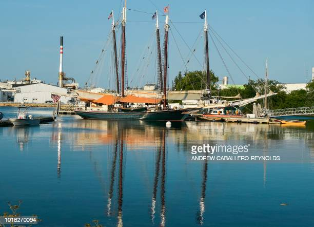 Traditional sailboats are reflected in a port in Rockland Maine on August 5 2018