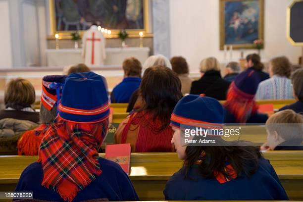 traditional sami wear, sami service, at a jokkmokk church, jokkmokk, sweden - peter adams stock pictures, royalty-free photos & images