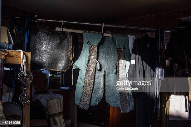 Traditional samurai clothing is seen hanging at a stable ahead of the Soma Nomaoi festival on July 26 2015 in Minamisoma Japan Every summer the...
