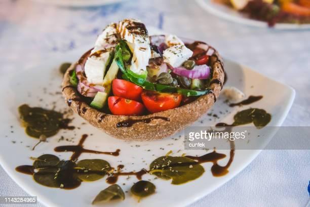 traditional santorini salad - kalamata olive stock pictures, royalty-free photos & images