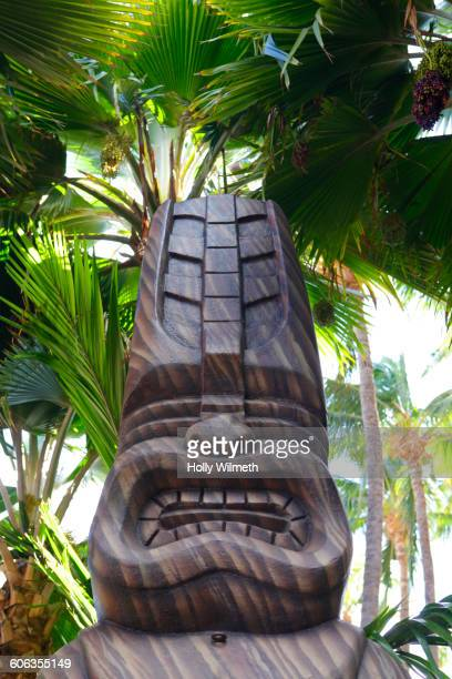 Traditional sculpture and palm tree