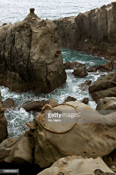 A traditional Shinto rope rings a hole in the rocks below the cave at the Udo Shrine dedicated to the memory of one of Japan's early emperor's foster...