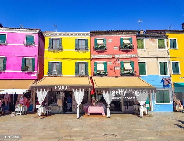 traditional shops of burano island, italy - burano foto e immagini stock
