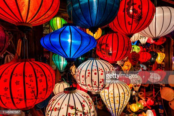 traditional silk hanging lanterns in hoi an city, vietnam - indochina stock pictures, royalty-free photos & images