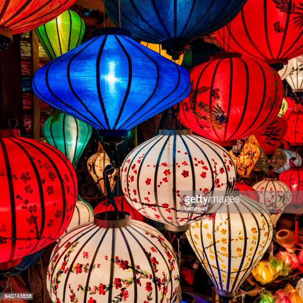traditional silk hanging lanterns in hoi an city, vietnam - traditionally vietnamese stock pictures, royalty-free photos & images