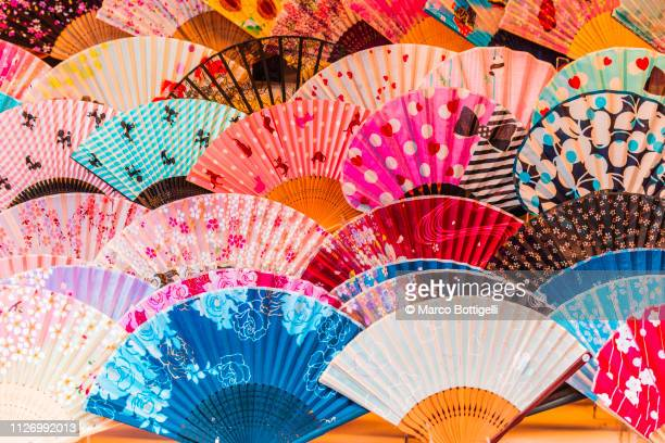 traditional silk japanese folding fans - japanese culture stock pictures, royalty-free photos & images