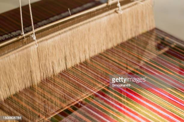traditional silk weaving can be seen in the countryside of thailand. - wool stock pictures, royalty-free photos & images