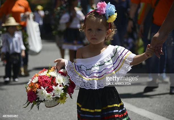 Traditional 'silleteritos' children participate in a parade of the Flower Festival on August 1 2015 in Medellin Antioquia department Colombia AFP...