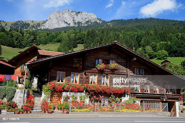 Traditional Simmentaler farmhouse near the village of Erlenbach at the valley Simmental Berner Oberland Switzerland
