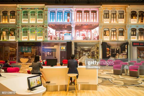 Traditional Singaporean Peranakan building facades adorn a wall in the Heritage Zone during a media preview of the new Terminal 4 at Changi Airport...