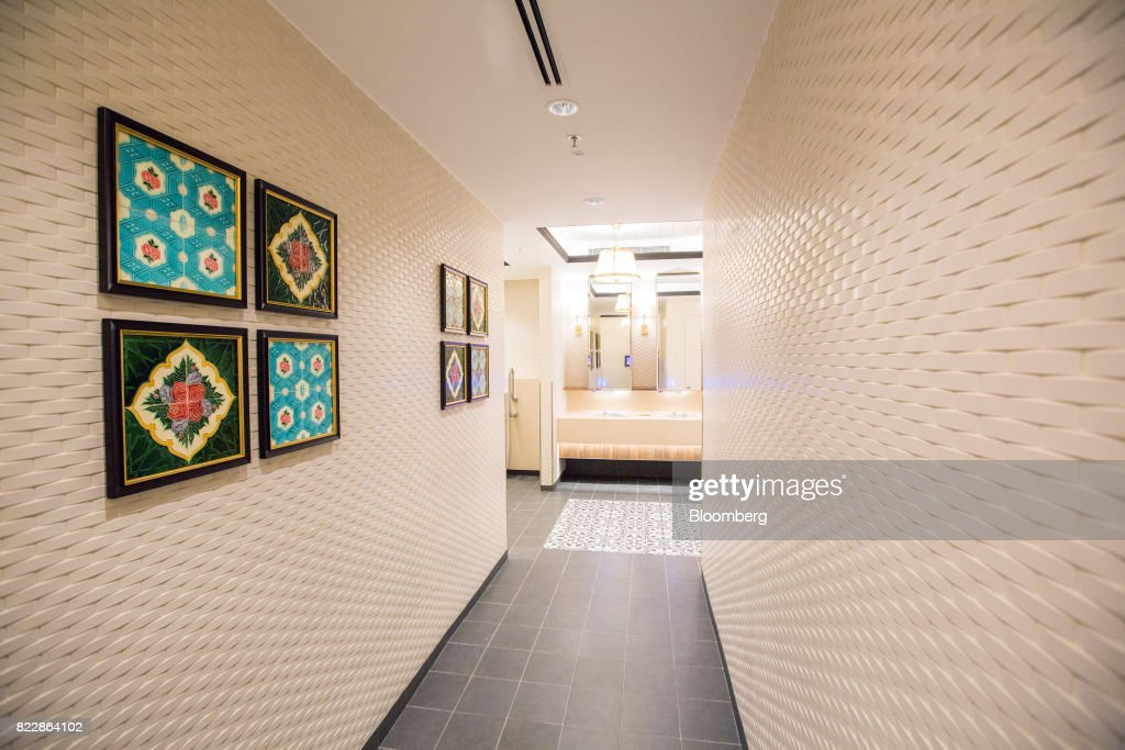 A traditional Singaporean Peranakan themed toilet in the Heritage Zone is seen during a media preview of the new Terminal 4 (T4) at Changi Airport in Singapore, on Tuesday, July 25, 2017. The terminal which will open later this year, will feature an array of fast and seamless travel (FAST) technologies to speed people-processing without the need for human supervision, from face-recognition software to automated bag-tagging and checking. Photographer: Nicky Loh/Bloomberg via Getty Images