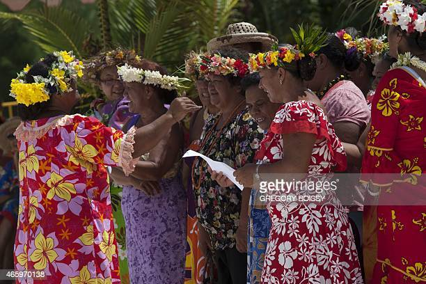 Traditional singers welcome French Overseas Territories Minister president of French Polynesia on March 11 2015 on the island of Maupiti west of...