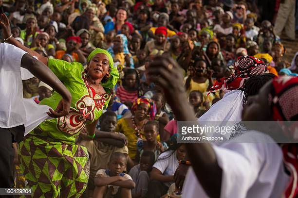 CONTENT] traditional singing and dancing during the festival of Niger in Segou Mali sahel