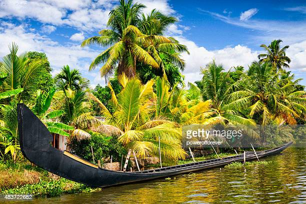 traditional snake boat on the kerala backwaters in india - kerala stock pictures, royalty-free photos & images