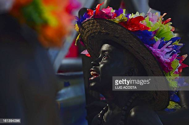 A traditional 'Son de Negro' dancer taked part in the second day of carnival parade in Barranquilla Colombia on February 10 2013 Barranquilla's...