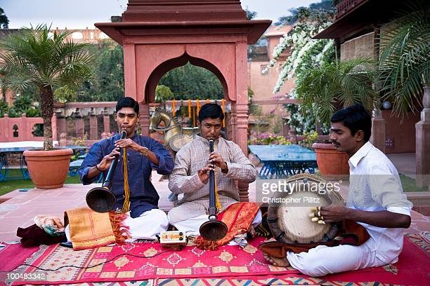 Traditional south indian musicians play at wedding