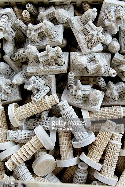 Traditional souvenirs of Pisa and its Leaning Tower are shown August 24 2002 in Pisa Italy The tower reopened in December 2001 after 10 years of...