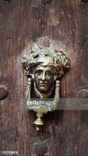traditional spain door knocker - door knocker stock photos and pictures