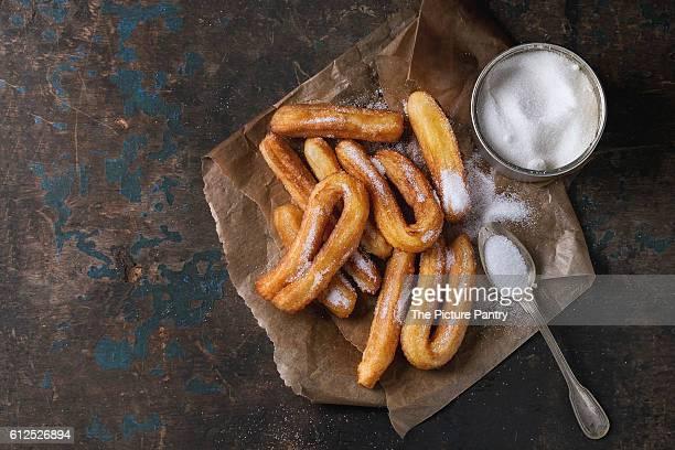 traditional spanish churros with sugar - churro fotografías e imágenes de stock