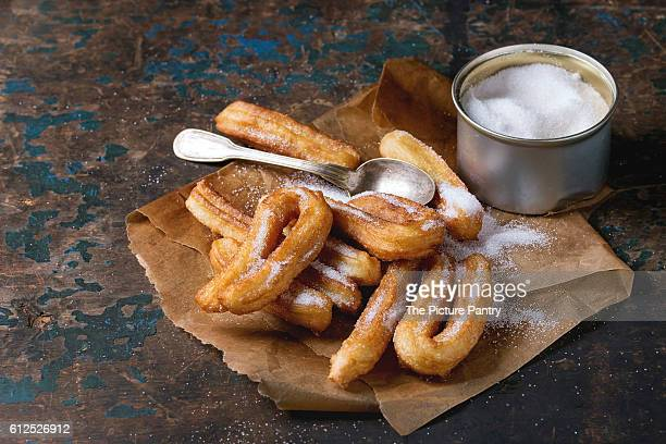 traditional spanish churros with sugar - churro stock photos and pictures