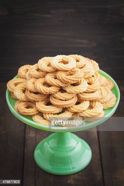 Traditional spritz cookies on green cake plate
