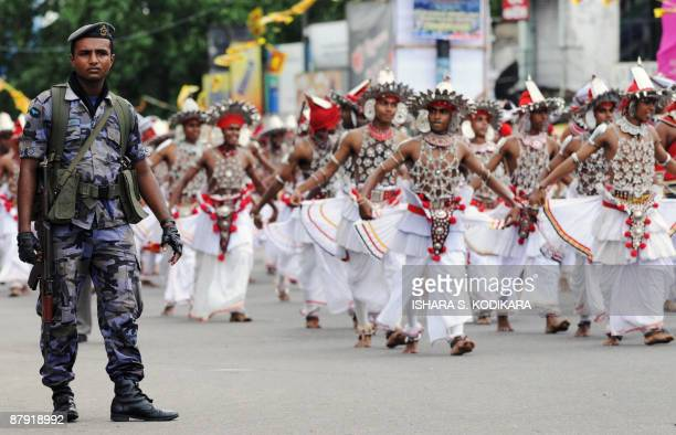 Traditional Sri Lankan Kandyan dancers perform at a state-sponsored festival to commemorate the defeat of the Tamil Tiger rebels in Colombo on May...