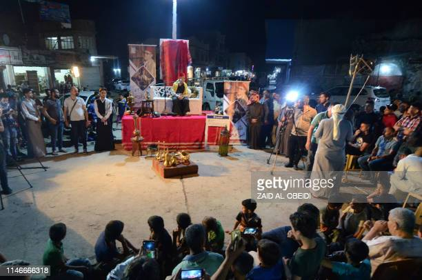 Traditional storyteller Abdel Wahed Ismail entertains an audience in the northern Iraqi city of Mosul during the holy Muslim month of Ramadan on May...