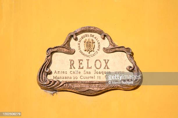 traditional street name sign in san miguel de allende, mexico - nameplate stock pictures, royalty-free photos & images