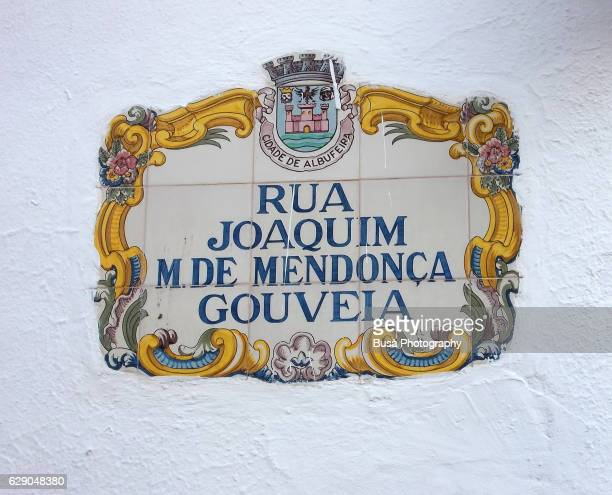Traditional street sign made of azulejos tiles in Albufeira, Algarve, Portugal