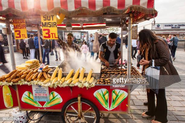 traditional street vendor in eminonu district - chestnut food stock pictures, royalty-free photos & images