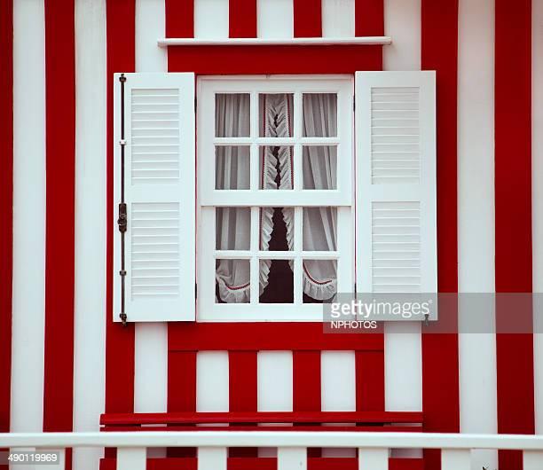 Traditional striped and colorful houses at Costa Nova do Prado in Aveiro, Portugal