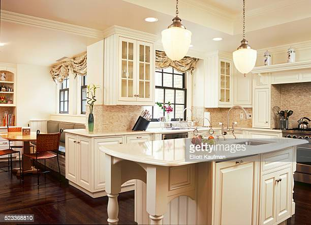 Traditional Style Kitchen with White Raised Panel Cabinetry