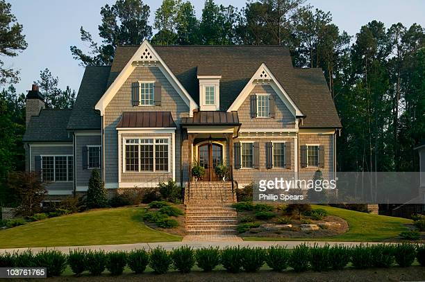 traditional suburban house - facade stock pictures, royalty-free photos & images