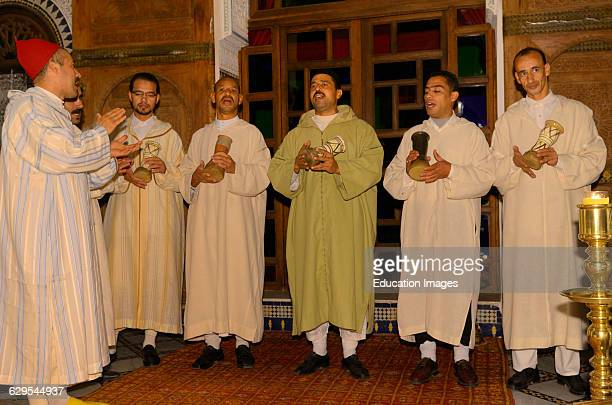 Traditional Sufi brotherhood music group with chanting with darboukas in Fes Morocco.