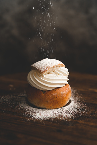 Traditional Swedish dessert Semla with whipped cream and sugar 1089775596