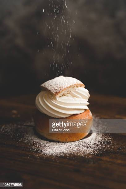 traditional swedish dessert semla with whipped cream and sugar - sweet food stock pictures, royalty-free photos & images
