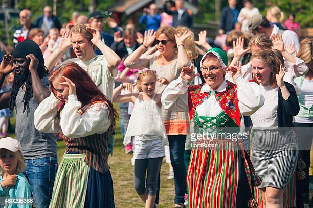 traditional swedish midsummer singing and dancing - midsummer sweden stock pictures, royalty-free photos & images