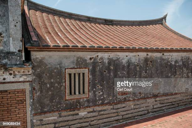 A traditional Taiwanese house still bears bullet holes and damage from the Battle of Guningtou an attempted invasion of Kinmen by Communist forces in...