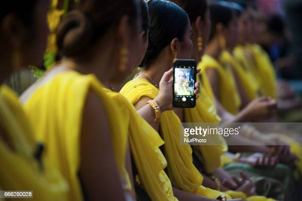 Traditional Thai dancers Selfie a photo perform during the Songkran parade on occasion for the upcoming Songkran Festival in Bangkok Thailand on 8...