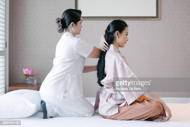 traditional thai massage - thai massage stock photos and pictures