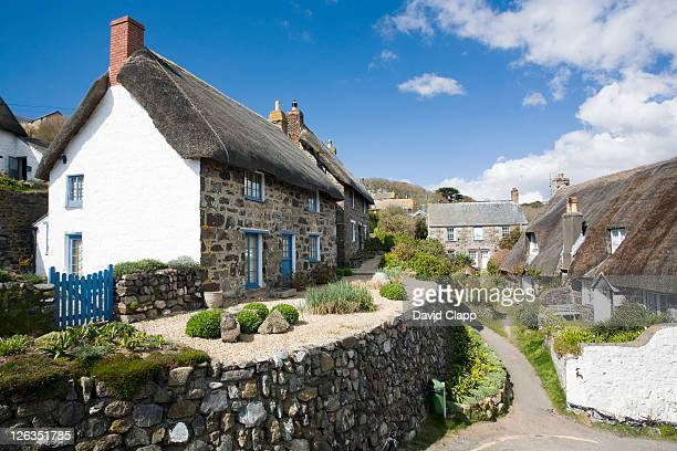 Traditional thatched cottages in the quiet village of Cadgwith Cove in Cornwall.